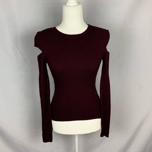 Garage maroon sweater with cut sleeves.